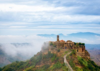 The charming Citiva di Bagnoregio emerges from low storm.