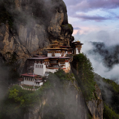 A beautiful day in Bhutan as soft fog swirls around the stunning structure of the Tigers Nest Monastery.